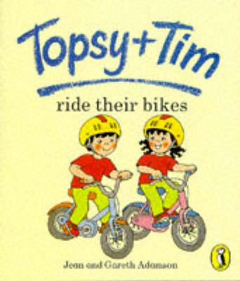 Topsy + Tim ride their bikes